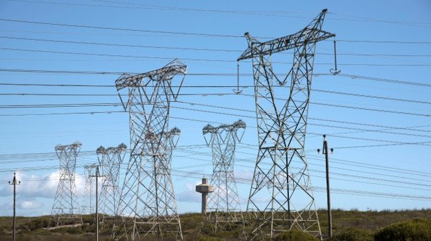 Power lines feed electricity to the national grid from Koeberg Nuclear Power Station. (Photo by: Education Images/UIG via Getty Images)