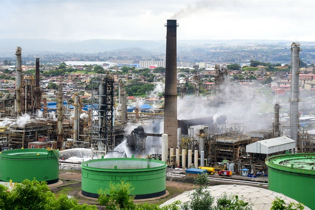 Firefighters work to keep the fire out at Engen Oil Refinery. (Darren Stewart, Gallo Images)