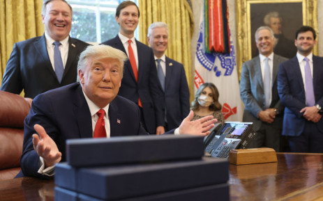 FILE: US President Donald Trump and his senior advisors in the Oval Office. Picture: AFP
